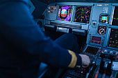 Pilot's hand accelerating on the throttle in  a commercial airliner airplane flight cockpit