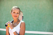 Portrait of a pretty, young, female tennis player