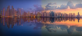 Niight to day cityscape with beautiful reflections in Dubai Marina