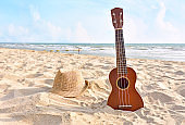 Summer Vacation with Guitar ukulele for relax on the beautiful beach