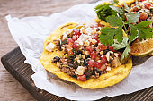 Spicy taco with meat, cheese and pomegranate