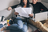 Young couple at home planning an investment