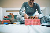 Woman packing Christmas gifts
