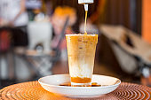 Iced coffee with milk in tall glasses