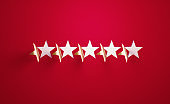 Five Golden Star Shapes Folding on Red Background - Five Stars Perfection Concept