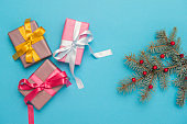 Christmas gift boxes with decoration on blue background.