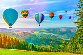 Hot air balloon flying over amazing mountains