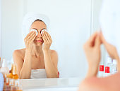 Woman doing face care