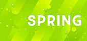 Bright green horizontal abstract banner with graphic elements and inscription Spring.