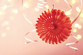 Holiday party background. Trendy Paper coral decoration and serpentine