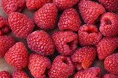 Fresh raspberry texture / Close up red raspberries fruit background