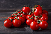 red cherry tomatoes on wooden table