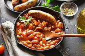 Grilled sausages with baked white beans