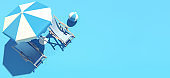 Two beach chairs and umbrella on blue background, summer concept