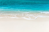 Maldives island with white sandy beach and sea