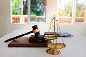 Gold brass balance scale isolated on book, Symbol of law and justice.