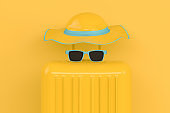 Summer, Travel Minimal Concept, Hat and Suitcase on Yellow Background
