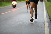 Group of people running race marathon