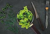 Green lettuce leaves.