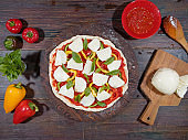 Preparing homemade vegetarian pizza