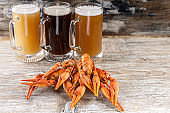 Beer and a boiled crayfishes on a wooden background
