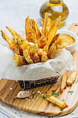 French fries in basket with mustard sauce