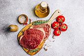 Fresh raw Black Angus beef steak on wooden board