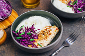 Buddha bowl dish with chicken fillet. Detox and healthy keto diet bowl concept.