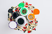 Various medications and vitamins, a pill bottle.