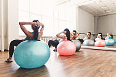 sporty women doing pilates exercise on  fit-balls