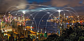 Technology Connection line between Panorama Hong Kong Cityscape skyscraper at twilight time, Hong Kong central and Kowloon island, data cloud computer and internet of things concept