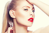 Attractive beautiful young model woman touching perfect healthy face skin.