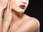 Partial beauty face, shoulders of model woman with red lips, perfect skin