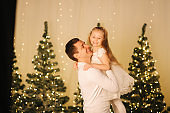 Dad play with his cute little daughter on holiday. Chrisrmas mood