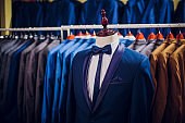 Row men suit jackets on hangers