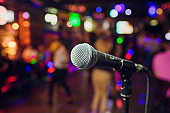 modern microphone for singing against beautiful blurry colored bokeh.