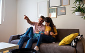 Happy family spending quality time at home together and watching tv.