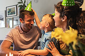 Happy family celebrating a birthday together at home.