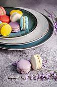 The concept of Scandinavian cuisine. French macaron dessert. Scandinavian plates handmade different size. Top view, copy space, flat lay