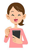 Smile of a woman operating a smartphone