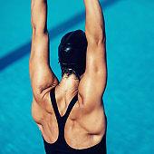 Female warming up on pool edge