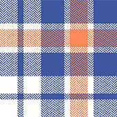 Plaid pattern vector graphic. Seamless bright herringbone pixel tartan check plaid background in blue, soft orange, and white for flannel shirt, blanket, or other modern summer textile design.