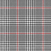 Classic glen check plaid pattern. Seamless hounds tooth vector plaid background in black, red, and white for jacket, skirt, trousers, or other modern autumn or winter tweed textile design.