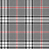 Glen plaid pattern. Classic seamless hounds tooth check plaid texture in black, red, and white for trousers, coat, skirt, jacket, or other modern fashion clothes print.