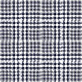Seamless glen pattern. Tweed check plaid in dark blue, grey, and white for jacket, skirt, coat, trousers, or other modern textile design.