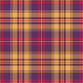 Halloween tartan check plaid pattern vector graphic. Seamless colorful plaid in purple, red, and yellow for flannel shirt, blanket, or other modern textile design. Striped texture.