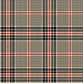 Seamless glen plaid pattern. Fabric texture in nearly black, gold beige, and red for jacket, coat, skirt, trousers, or other fashion textile print. Background for autumn and winter clothing design.