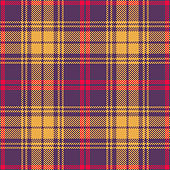 Halloween plaid pattern. Seamless bright tartan check plaid in purple, yellow, and red for flannel shirt, skirt, jacket, dress, or other modern fabric design. Striped texture.