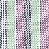 Seamless stripe pattern. Vertical stripes in dark blue, pink, and green on white background. Texture for bed sheet, duvet cover, mattress, pillow case, or other modern textile print.