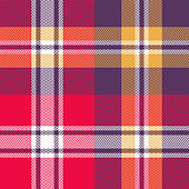 Halloween tartan pattern. Seamless festive colorful check plaid in purple, red, yellow, and white for flannel shirt, blanket, or other modern textile design. Herringbone woven pixel texture.